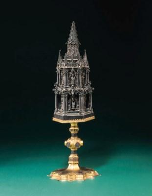 A gilt-copper, silver and enam