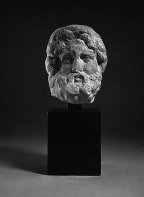A ROMAN MARBLE HEAD OF A GOD