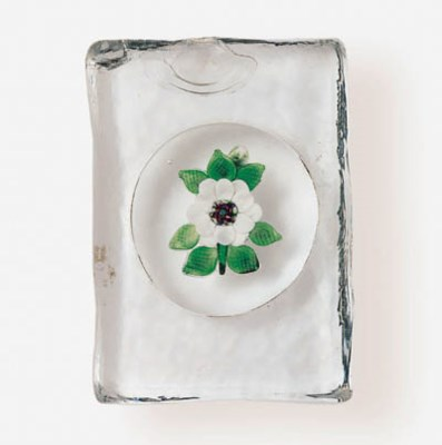 A FLORAL PLAQUE WEIGHT