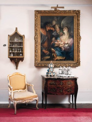 A giltwood hanging wall cabine