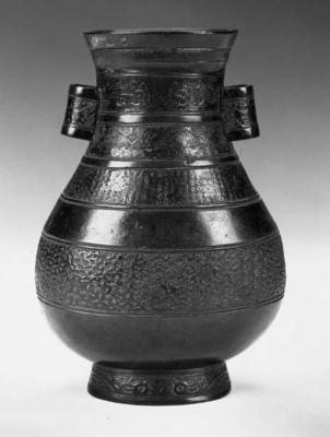 A Ming bronze arrow vase