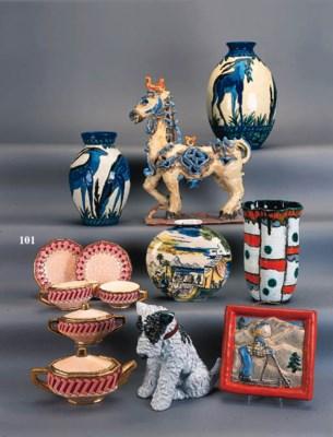 A Longwy pottery tete a tete