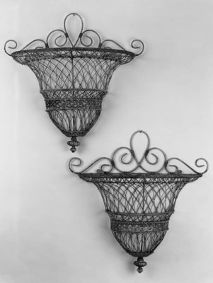 A pair of painted wirework jar