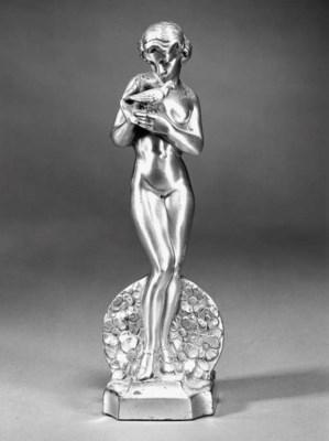 An Art Deco silvered spelter f