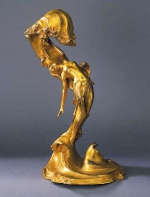 A gilt bronze figural table la