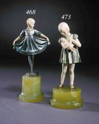 A silvered spelter and ivory f