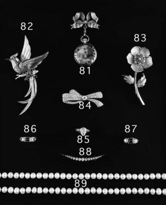 AN EMERALD AND DIAMOND THREE-S