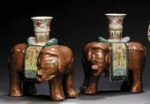 A LARGE PAIR OF ELEPHANT CANDL