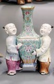 A FAMILLE ROSE VASE AND FIGURE
