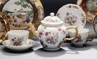 A PAIR OF FAMILLE ROSE TEAPOTS