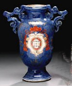 A TWO-HANDLED ARMORIAL VASE