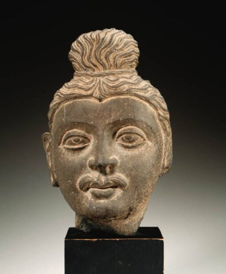 A gray schist head of Buddha