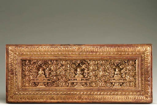 A fine gilt and carved wood ma