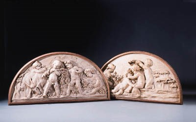 A pair of white-painted carved