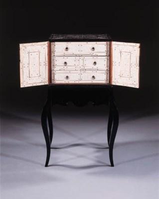 A Goa ebony table cabinet on s