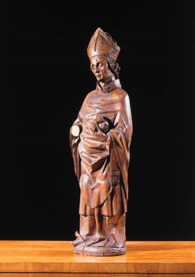 A carved wooden figure of Sain