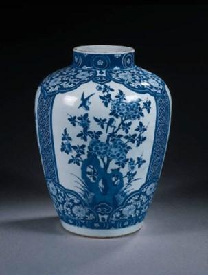 A blue and white oviform jar