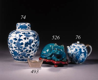 A blue and white jar and cover