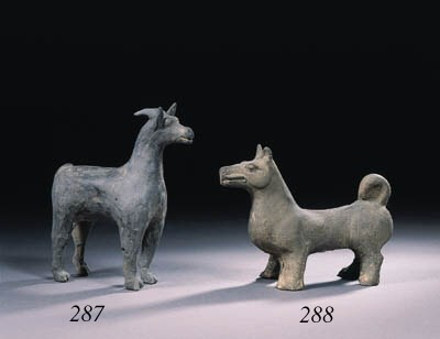 A grey pottery figure of a dog