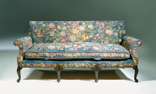 A MAHOGANY AND NEEDLEWORK SOFA