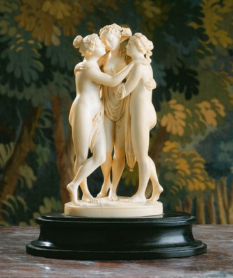 A carved ivory group of the Th