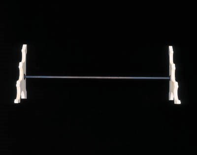 AN IVORY STAND FOR THREE FLUTE