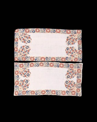 A pair of linen bolster covers