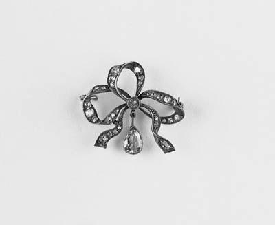 A diamond bow brooch,