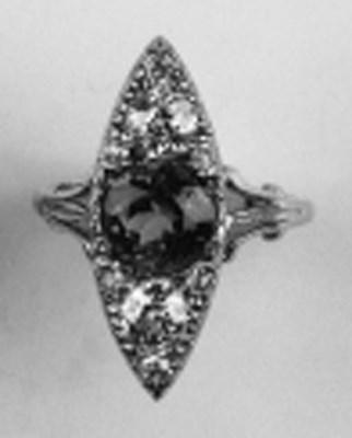 A diamond and peridot marquise