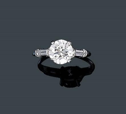 A SINGLE STONE DIAMOND RING