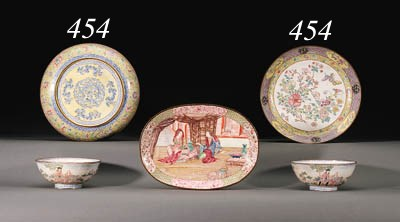A PAIR OF PAINTED ENAMEL DISHE
