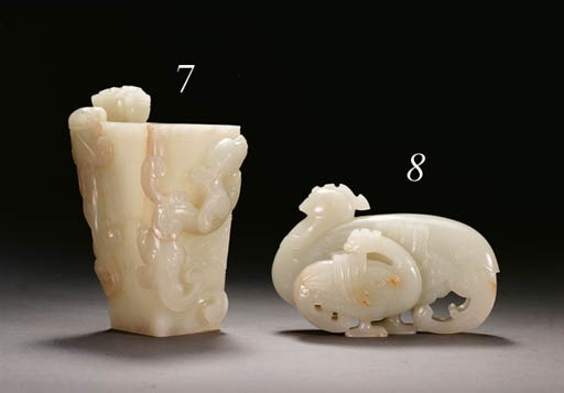 A WELL-CARVED WHITE JADE BIRD