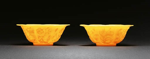 A PAIR OF MOLDED YELLOW GLASS