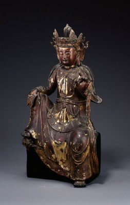 A LACQUERED GILT-BRONZE FIGURE