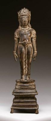 A rare bronze figure of a Jina