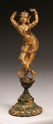 A gilt bronze figure of a danc