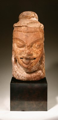 A large red sandstone head of