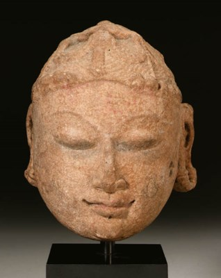 A small red sandstone head of