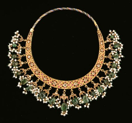 An enameled gold and gem-inset