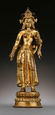 A rare gilt bronze figure of T