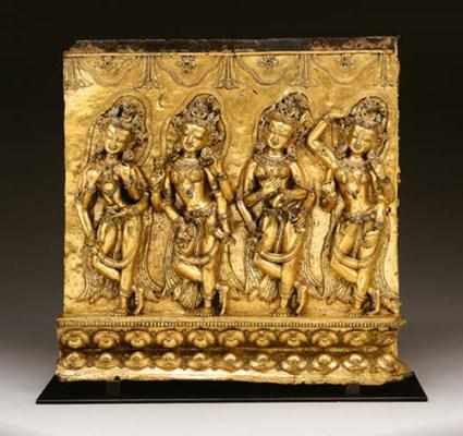 A gilt bronze frieze