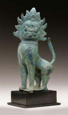 A bronze figure of a lion