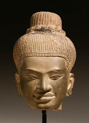 A stone head of a female deity