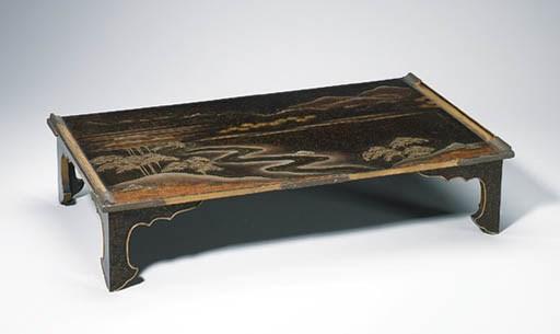 A LACQUER WRITING TABLE (BUNDA