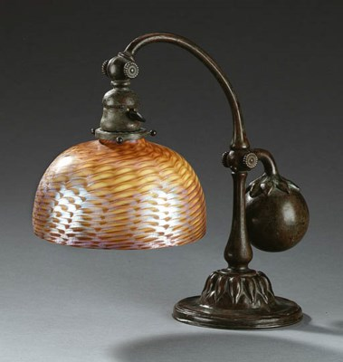 A FAVRILE GLASS AND BRONZE COU