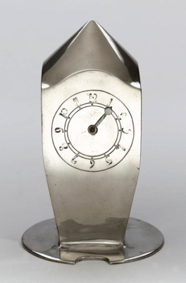 A PEWTER CLOCK