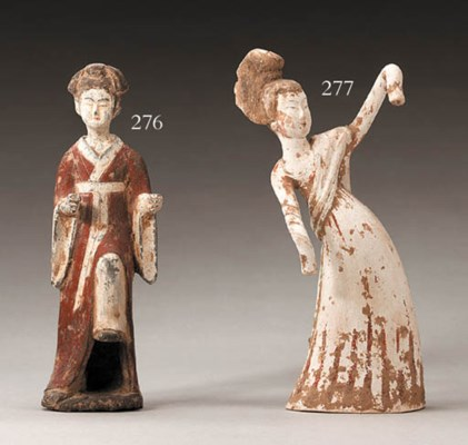 A Small Painted Pottery Figure