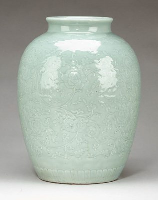 A Large Celadon-Glazed Carved