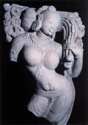A Red Sandstone Figure of a Ri