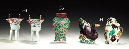 A PAIR OF LIBATION CUPS AND A